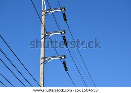 High-voltage electricity lines from the electricity distribution stations to the rural areas of Thailand #1561584538