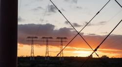 High voltage electricity poles in the evening. Silhouette High voltage electric tower