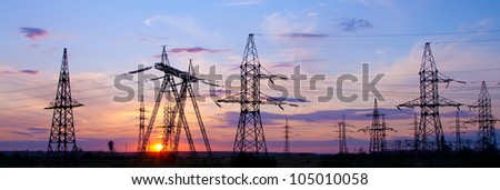 High voltage electricity pylon over sunset