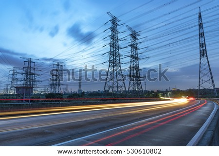 High voltage, high speed road car track in the background of high voltage towers #530610802