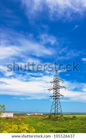 High voltage lines beneath the blue cloudy sky