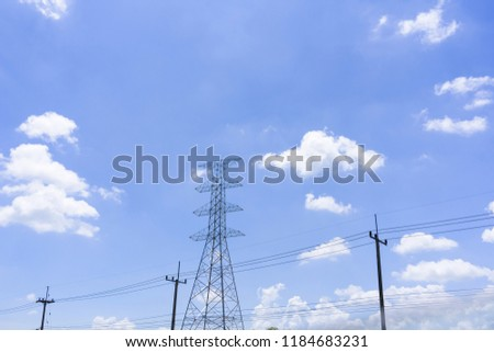High voltage pole with blue sky on cloud background. #1184683231