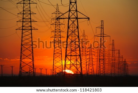 high voltage post at sunset.