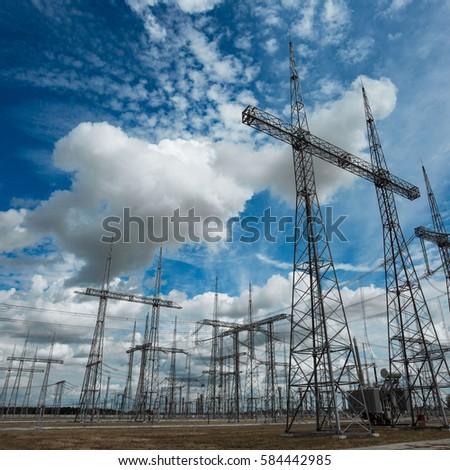 High voltage post. High-voltage tower sky background.  #584442985