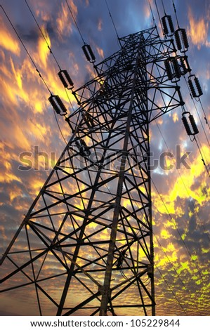 high voltage post.High-voltage tower sunset  sky background.