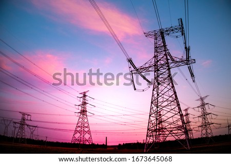 High voltage power cord. Sub-station. High voltage transmission tower. A distribution substation with power lines and transformers. Stockfoto ©