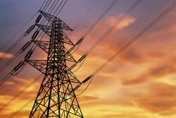 High voltage power  energy transmission towers Have a complex steel structure In the evening. high-voltage power lines at sunset, high voltage electric transmission tower