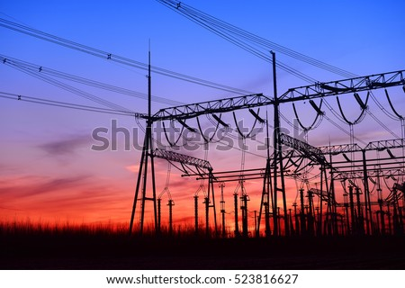 High voltage power grid under the setting sun  #523816627