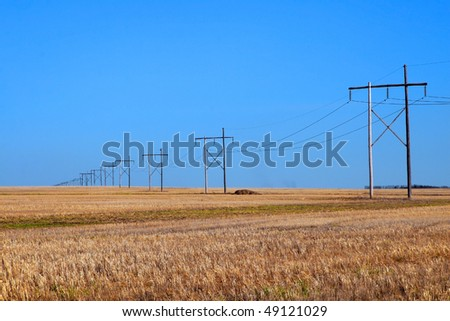 stock-photo-high-voltage-power-line-crosses-large-expanse-of-prairie-grain-field-under-a-clear-blue-sky-49121029.jpg