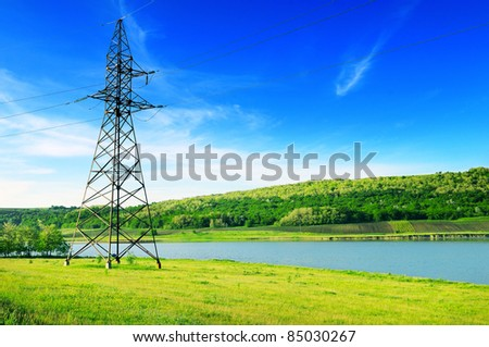 High-voltage power line on the shore of the lake.