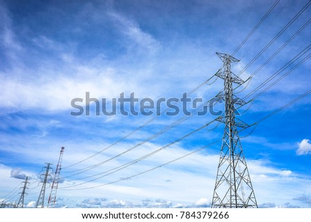 high-voltage power lines at blue sky electricity transmission pylon. Part of high-voltage substation with switches and disconnects #784379266
