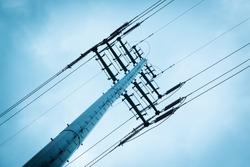High voltage power lines under sky.