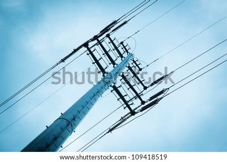 High voltage power lines under sky.