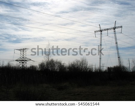 High voltage power tower and electrical lines against sky. #545061544
