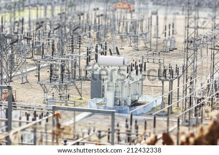 High voltage power transformer substation, tilt-shift effect - stock photo