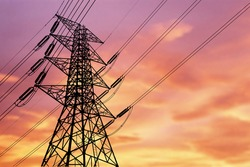 High voltage power transmission towers Have a complex steel structure In the evening. high-voltage power lines at sunset,high voltage electric transmission tower