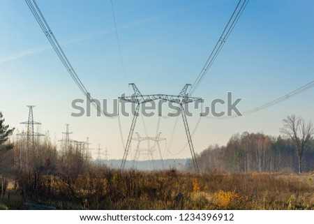 High voltage powerline against the forest. #1234396912