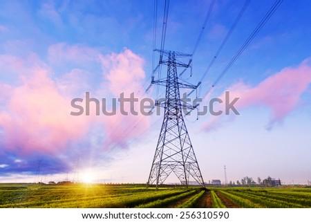 high voltage pylon in field with skyline