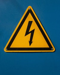 High voltage sign with lightning on a blue background. Danger high voltage. High voltage style modern font design, alphabet letters and numbers. Safety signs. Warning sign. Lightning symbol