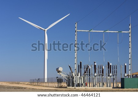 high-voltage substation and windmill with blue sky