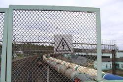 High voltage. The sign behind the bars. Railway tracks. Danger zone. Don't log in
