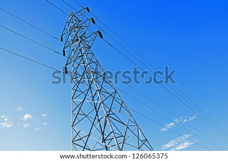 High-voltage tower in sky background.