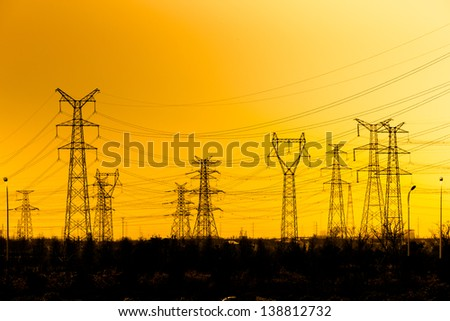 High voltage towers aganist the sunset background. #138812732
