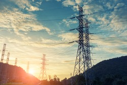 High voltage towers on skies background, Transmission line tower.