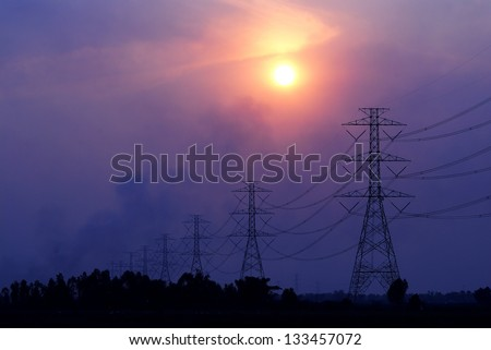 High voltage towers on the sunset in Thailand