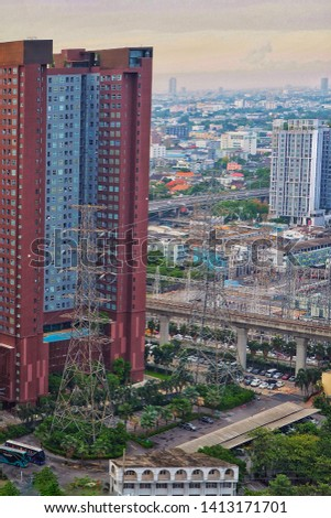 High voltage - Transmission line and transmission tower near condominium downtown Bangkok city , Thailand. #1413171701