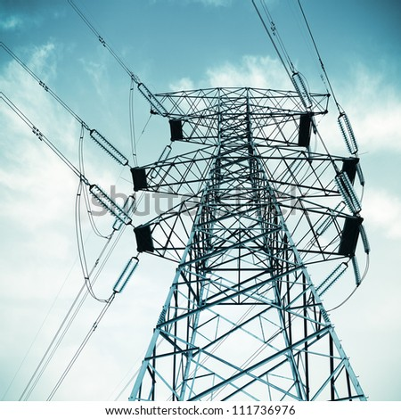 high voltage transmission pylon on blue sky background