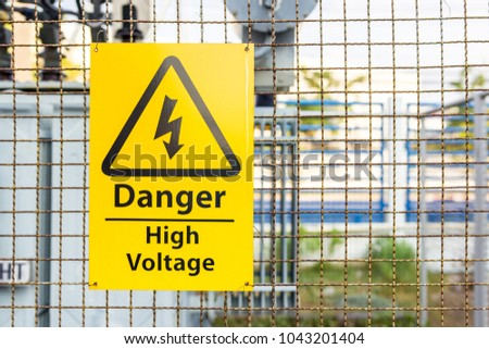 High Voltage Warning Signs yellow mark on the wire mash wall safety concept for  people