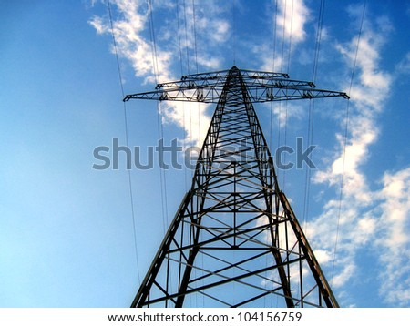 high voltage with blue sky and clouds