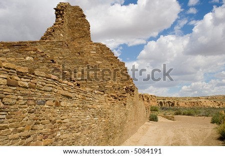 High walls of Pueblo Bonito, in Chaco Canyon, stand against the sky