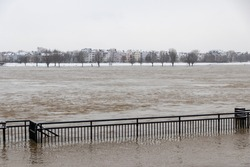 High water after heavy rainfall and snow melting in February drowned the flooded coast as weather catastrophe in Düsseldorf shows extreme weather, high tide and insurance risks at the coast with flood