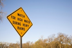 High Water Warning Sign During Heavy Rains