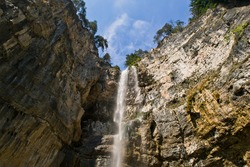 High waterfall in a forest in northern Italy, Alps: cold and pure water