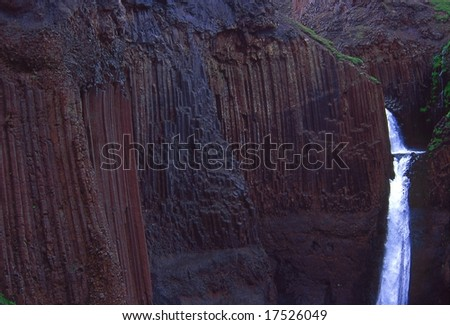 High waterfall in basalt organs, Hengifoss, Iceland - stock photo