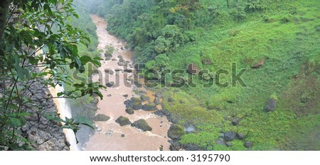 High waterfall in the tropical jungle with a river - Cameroon - Africa - Panorama.