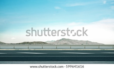 High way and guard rail with beautiful mountain background. 3D Rendering