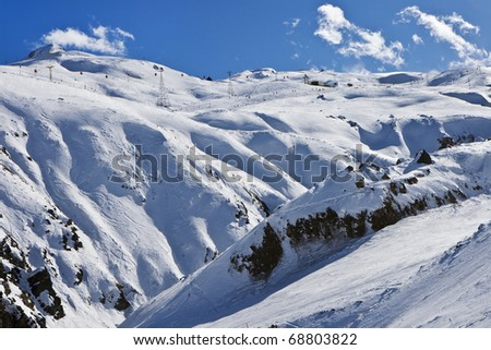 High winter mountains with blue cloudy sky