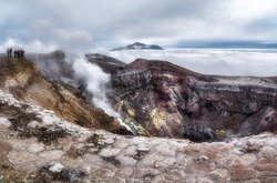 Higher than clouds. Fumaroles and the crater of Gorely volcano. Russia, Kamchatka Territory. August 2018