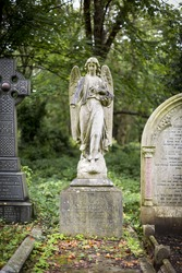 Highgate Cemetery, Highgate, London. There are approximately 170,000 people buried in around 53,000 graves in Highgate Cemetery, notable for many of the people buried there inc. Karl Marx