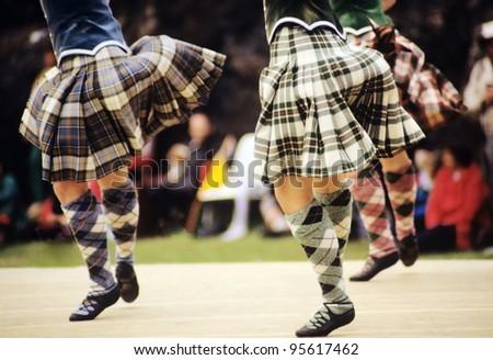 highland dancers at a highland games in scotland, uk