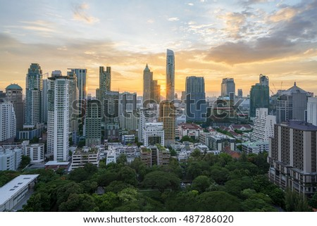 Highlight shadow of Bangkok city in sunset time.  (With warm sunlight effect create reflection in the sky, building and blur trademark, brand, logo)