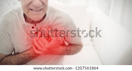 Highlighted pain against senior man having cardiac arrest #1207561864