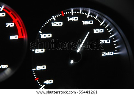 highlighted speedometer in the process of a car ride