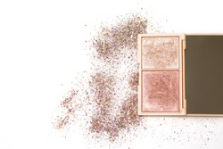 highlighter palette of a silver and pink shades with a scattered glitter on a white background. Space for text