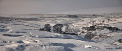 Highlighting old mining spoil heaps, a heavy snowfall in February covers the land around the Yorkshire Dales