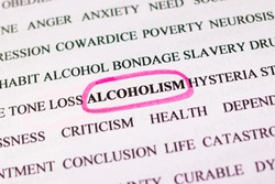 Highlighting the word alcoholism in in english word set with a pink marker. The problem of alcohol dependence, for social advertising. Bad habit. Magnifying glass view.